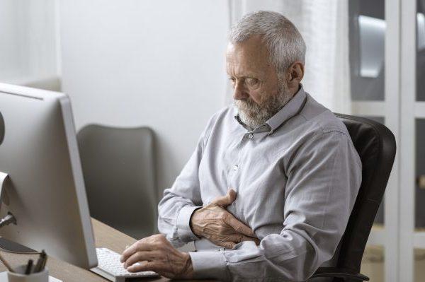 senior man having a bad stomach pain WPR6582 e1569476341895